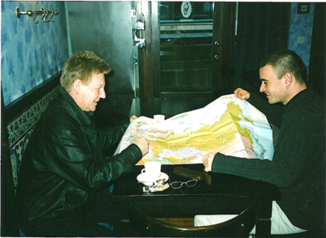 Ron Peck and collaborator Grégory Maillot pore over a map of Russia before making their first work trip there under NESTA sponsorship.